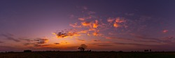 Panorama  beautiful Sunset with dramatic sky clouds.Sunrise with cloud over rice field.Vivid sky on dark clouds.Long shots photo background for use.
