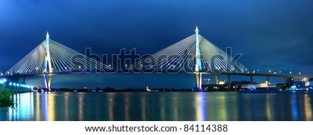 Panorama Bhumibol Bridge at night in Bangkok, Thailand.