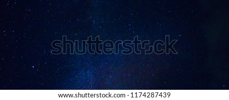 Panorama blue night sky milky way and star on dark background.Universe filled with stars, nebula and galaxy with noise and grain.Photo by long exposure and select white balance.Dark night sky. #1174287439