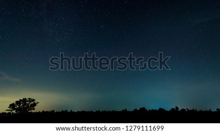 Panorama blue night sky milky way and star on dark background.Universe filled with stars, nebula and galaxy with noise and grain.Photo by long exposure and select white balance.Dark night sky. #1279111699
