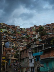 Panorama cityscape of colorful brick houses buildings in Comuna 13 San Javier neighborhood poverty slum hills slopes in Medellin Colombia South America