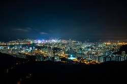 panorama cityscape view of Hong Kong at night, the atmosphere of night lights in the city of the harbor, trade, transportation and international export