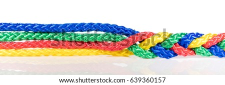 Panorama, colorful ropes are connected, concept cooperation and cohesion