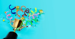 Panorama concept. Celebrating the success that has happened, Gold trophy placed on a blue background. There are gift boxes and colorful ribbons. Free space to put text into advertising media.
