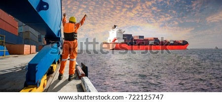 Panorama, Container ship vessel leaving departure from the port terminal after completion of loading/discharging operation by gang of mooring attending at last party with sunset scenery in background