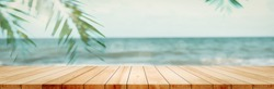 Panorama empty clean wood board counter table top blur sunlight bokeh on summer patio beach walls background for product scene panoramic display, Backdrop wooden desk in pastel green house backyard.