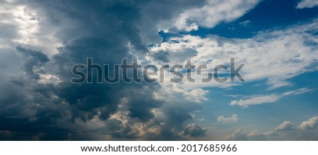 Panorama evening dramatic sky with blue, white and orange clouds. colorful dramatic sky with cloud at sunset. Dramatic Cloudscape Area for Background Foto stock ©