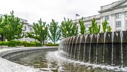 Panorama frame Circular water fountain with Utah State Capital Building in Salt Lake City