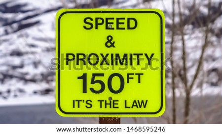 Panorama frame Speed and Proximity road sign against a snow covered mountain in winter #1468595246