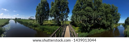 Panorama from a bridge over a canal in between Bartlehiem and Aldtsjerk in Friesland, The Netherlands #1439013044