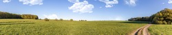 Panorama from beautiful meadows and farmland in hesse Germany in summer.