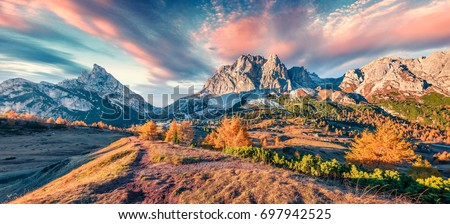 Panorama from top of Falzarego pass with Lagazuoi mountain range. Colorful autumn morning in Dolomite Alps, Cortina d'Ampezzo locattion, Italy, Europe. Beauty of nature concept background.