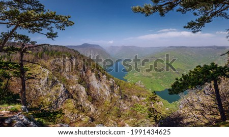 Panorama from viewpoint Banjska stena in Tara national park of Serbia. Touristic site, observation point with view over lake Perucac, Drina canyon steep cliffs and Bosnia slopes. Stock photo ©