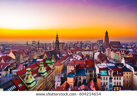 Panorama illuminated old town of Wroclaw at night. Popular travel destination in Poland. High dynamic range. #604214654