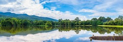 panorama image of lake and the mountain with beautiful blue sky in evening time at ang kaew in Chiang Mai University ,Thailand .