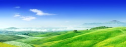 Panorama, Italian beautiful landscape, foggy rolling fields of Tuscany in light of the rising sun