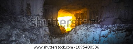 Panorama, light at the end of the tunnel. The Cave of Zedekiah. quarries of King Solomon, located under the Temple Mount. Stones, dark vaults, side lighting.