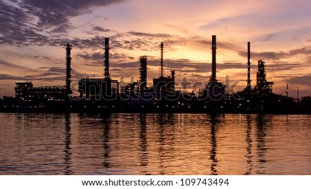 PANORAMA lonely, Sunrise, oil refinery factory with reflection on the river.