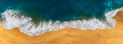 Panorama of a clean beach. Aerial photography of a clean sandy beach. Beautiful beach with yellow sand. The sea without the garbage. Aerial photography of the seascape. Copy space