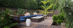 Panorama of a contemporary outdoor conversation inspired by oriental design.