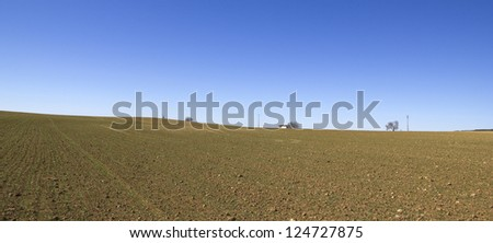 Panorama of a field in Castilla la Mancha. Ground cereals. Spain. Mediterranean landscape.