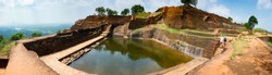 Panorama of a large reservoir of water and a large number of steps in the ancient ruins of the Lion's Rock. Sigiriya, Sri Lanka. high resolution.