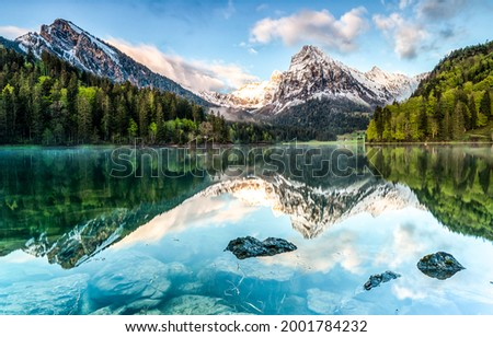 Panorama of a mountain lake. Mountain lake landscape. Lake in mountains. Mountain lake view