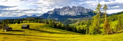 Panorama of a mountain valley with cabins. Mountain panoramic landscape. Beautiful mountain panorama. Mountain panorama