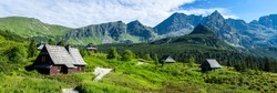 Panorama of a mountain village. Village in mountains. Village in mountain valley. Mountain village panorama