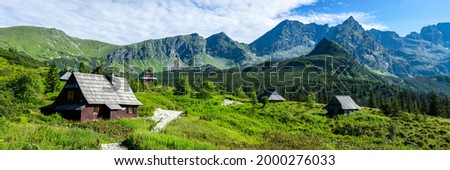 Panorama of a mountain village. Village in mountains. Village in mountain valley. Mountain village panorama Stockfoto ©