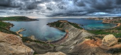 Panorama of a storm over Ghajn Tuffieha in Malta on a cold winter day