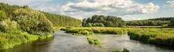 panorama of a summer landscape on the banks of the Ural river forest, Russia, August