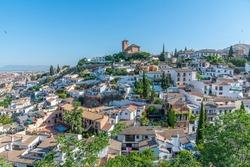 Panorama of Albaicin dominated by San Nicolas church in Granada, Spain