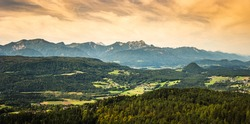 Panorama of Alpine mountains near Lake Worthersee and Velden city. Travel destination in Austria