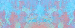 Panorama of an old painted wall. Colorful cracked stucco. Bright background for your projects.