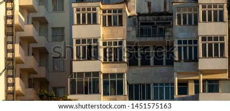 Panorama of architectural detail of facades of residential buildings at the Copacabana beach boulevard with weathered exteriors