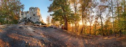 Panorama of autumn forest with Uhrovec castle in Slovakia at sunset