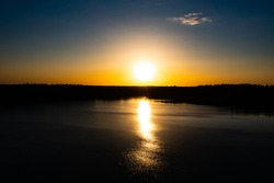 Panorama Of Autumn River Landscape In Belarus Or European Part Of Russia At Sunset. Sun Shine Over Blue Water Lake Or River At Sunrise. Nature At Sunny Morning. Woods With Orange Foliage On Riverside