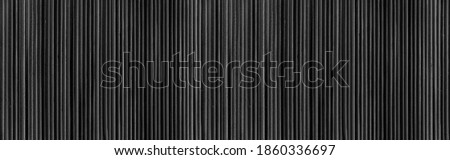 Panorama of Bamboo wall or Bamboo fence texture. Old black tone. Natural bamboo fence texture background