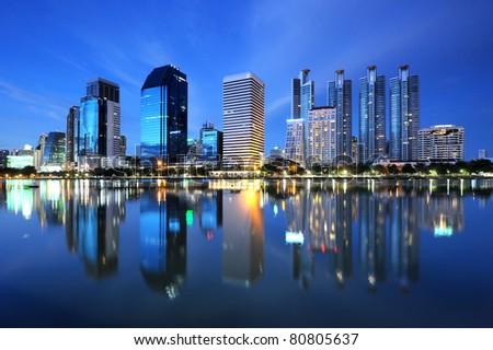 Panorama of Bangkok city downtown at night with reflection of skyline, Bangkok,Thailand