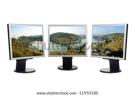 Panorama of bay (my photo) on computer screens, isolated on white background