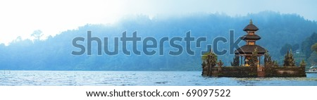 Panorama of beautiful Bali water temple on Bratan lake at mysterious foggy morning