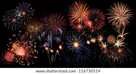 Panorama of beautiful colorful holiday fireworks on the black sky background,  long exposure