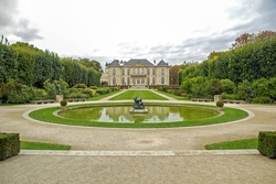panorama of beautiful garden with pond in Auguste Rodin museum. Paris, France