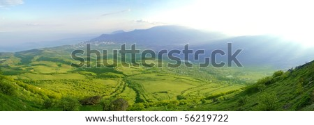 Panorama of Beautiful Mountain Valley with Sunlight