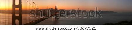Panorama of beautiful sunrise over Golden Gate Bridge, San Francisco, California