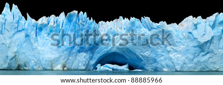 Panorama of blue icebergs isolated on black