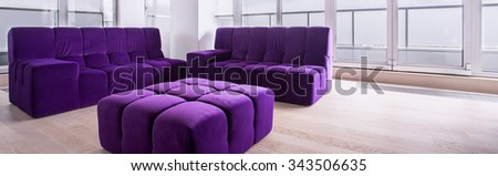 Panorama of bright contemporary lounge interior with purple furniture #343506635