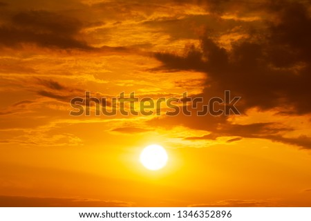 Panorama of brightly yellow sun on the orange sky with clouds at golden hour natue background sunrise or sunset scene #1346352896