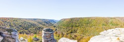 Panorama of canaan valley mountains in Blackwater falls state park in West Virginia during colorful autumn fall season with yellow foliage on trees, rock cliff at Lindy Point